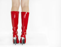 Red boots. Detail of woman wearing red boots Royalty Free Stock Photo
