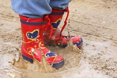 Red Boots. Little boy with red boots in rain stock images