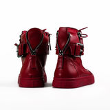 Red boots over white Stock Images