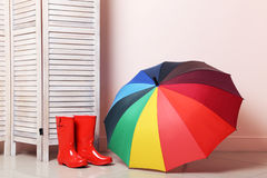 Red boots with umbrella Stock Photos