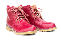 Red boots and untied shoelaces Royalty Free Stock Image
