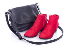 Red bootties and black handbag Stock Photography