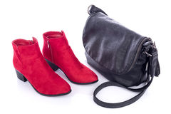 Red bootties and black handbag Stock Images