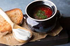 Red borsch soup. Russian ukrainian traditional beetroot red soup with sour cream royalty free stock photography