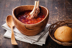 Red borsch. With traditional Ukrainian bread pampushki on dark wooden background royalty free stock photography