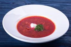 Red borsch in a white plate stock photos