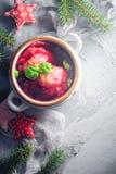 Red borscht dumplings Christmas table place text stock image
