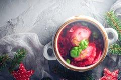 Red borscht dumplings Christmas table place text stock photo