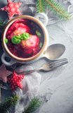 Red borscht dumplings Christmas table place text cutlery stock photography