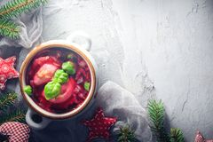 Red borscht dumplings Christmas table place text. Red borscht with dumplings on a Christmas table. Place for text stock photo