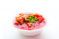Red borscht with green onion Stock Photography