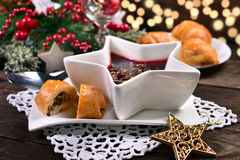 Red borscht and mushroom pastries for christmas eve Stock Photos