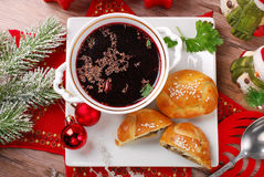 Red borscht and pastries for christmas eve Stock Photography