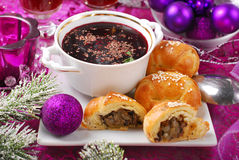 Red borscht and pastries with mushrooms for christmas Stock Photos