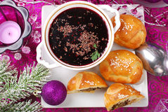 Red borscht and pastries with mushrooms for christmas Royalty Free Stock Photo