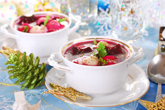 Red borscht with ravioli for christmas Royalty Free Stock Photo