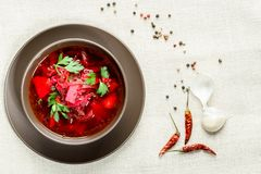 Red borscht soup in brown bowl top view, on white tablecloth. Red borscht soup in brown bowl top view, on white tablecloth Royalty Free Stock Photos