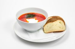Red borscht soup with dill in white bowl. royalty free stock images