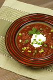 Red borscht with sour cream in ceramic  bowl Royalty Free Stock Images