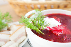 Red borscht with sour cream and dill in a white tureen Royalty Free Stock Photography