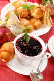 Red borscht and yeast pastries for christmas Royalty Free Stock Photography