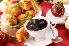 Red borscht and yeast pastries for christmas Royalty Free Stock Photo