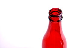 Red bottle. One empty red bottle in the wright side of the image Royalty Free Stock Photos