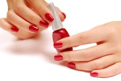Red bottle of nail polish Royalty Free Stock Photography