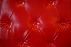 Red bottoned on leather pattern Stock Photo