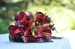 Red Bouquet of Flowers on Table Stock Photo