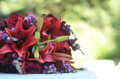 Red Bouquet of Flowers on Table Royalty Free Stock Images