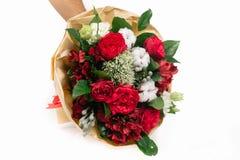Red bouquet of roses,  alstroemeria, trachelium and brunia. Bouquet of roses, cotton, alstroemeria, trachelium and brunia on white background Stock Image