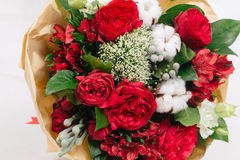 Red bouquet of roses, cotton, alstroemeria and brunia. Bouquet of roses, cotton, alstroemeria, trachelium and brunia on white background Stock Photography