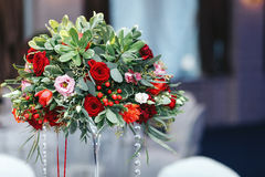 Red bouquet of roses, ranunculus, greenery,  decorated with crys Royalty Free Stock Photography