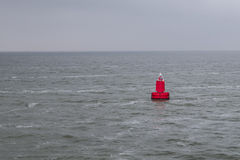 Red bouy floating in sea Royalty Free Stock Images