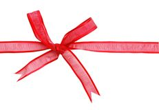 A red bow. Decorative red silk bow on background Stock Image