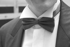 Red bow. Man in black suit with bow tie Stock Images