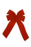 Red bow. A red velvet ribbon on white background Stock Image