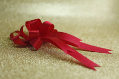 Red bow and background in gold Stock Photography