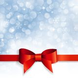 Red bow on a background snowflakes Royalty Free Stock Photography