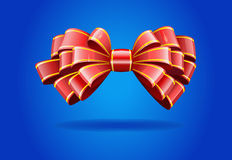 Red bow on a blue background. Stock Photos