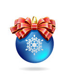 Red bow on a blue ball. Royalty Free Stock Photography