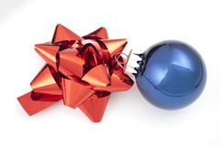 Red bow and blue christmas. Ball on white Royalty Free Stock Photography