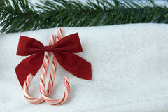Red bow candycane background Stock Photography
