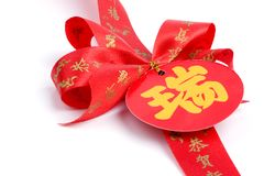 Red bow and chinese alphabet Royalty Free Stock Photos