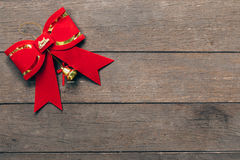 Red bow christmas on wood background with copyspace Royalty Free Stock Photography