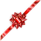 Red bow with diagonal ribbon with golden strips Royalty Free Stock Photography