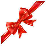 Red bow with diagonal ribbon with golden strips Royalty Free Stock Images