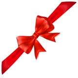Red bow with diagonally ribbon Royalty Free Stock Photos