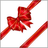 Red bow with diagonally ribbons with golden strips. Bow of red wide ribbon with diagonally ribbons with golden strips Stock Photography
